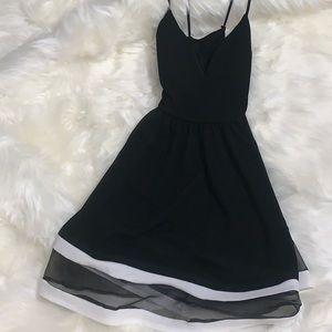 Cute black & white dress with a crisscross back